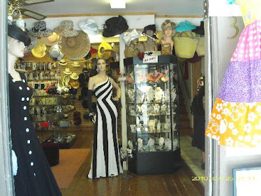 Shopping...dresses and hats in this shop...