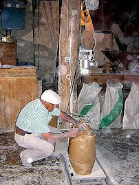 báscula de pesada y cosedora