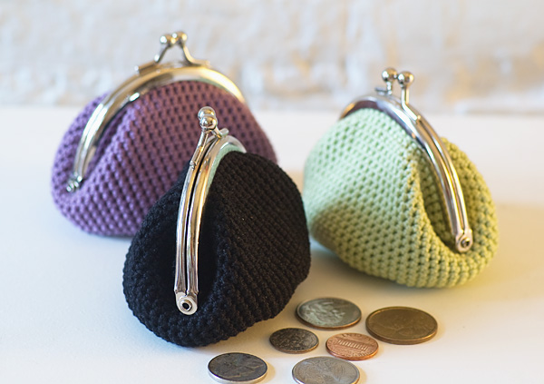 This crochet coin pouch reminds me of my first Purse when I was f...
