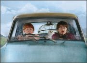 Ron, Hedwig (in cage in back seat), and Harry in the Ford Anglia from Chamber of Secrets