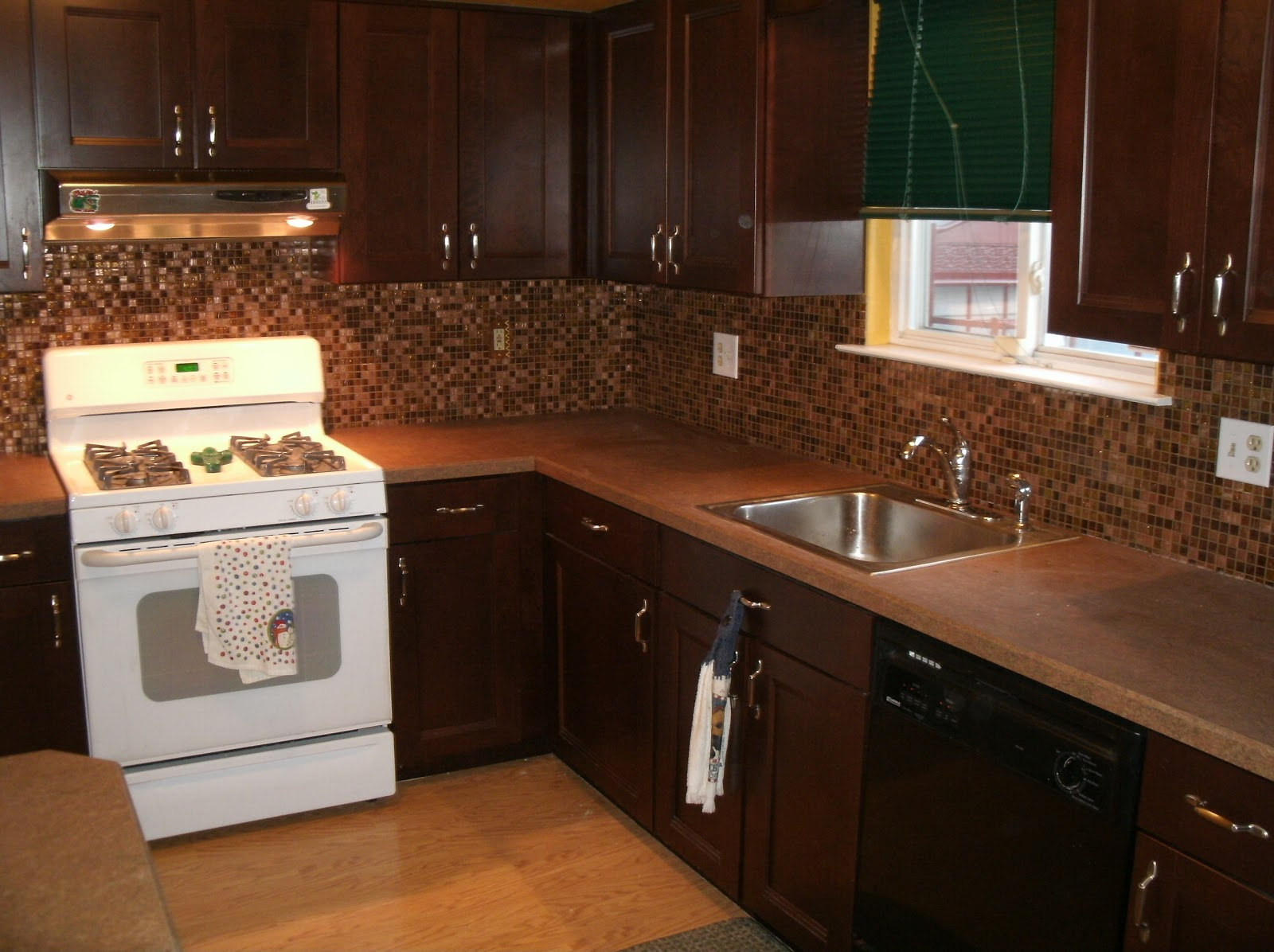 White Backsplash with Cherry Wood Kitchen Cabinets
