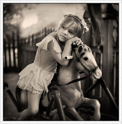 Simple And Cute Baby Girl With Her Horse