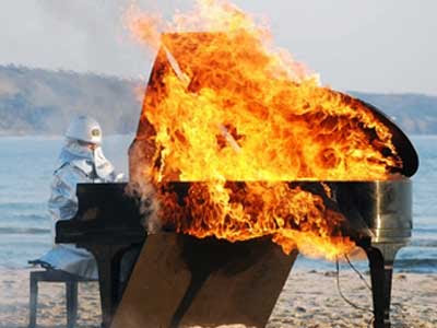 A performance with a burning piano