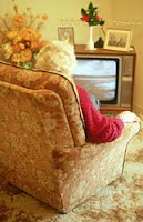 An old woman watching Tv