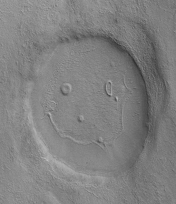 A crater on mars resembling a happy face