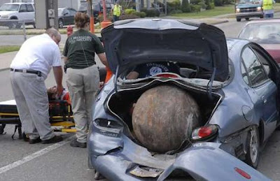 Runaway ball wrecks car