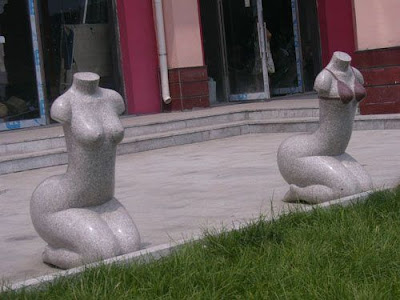 Nude female stone carving seats