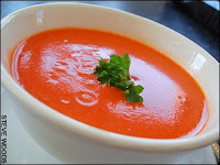 A bowl of tomato soup lying on the table