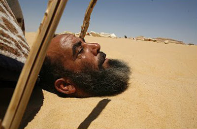 kamal al Masry buried in the sand