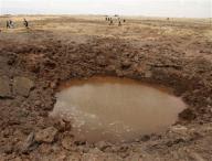 A crater 65 feet wide and 22 feet deep