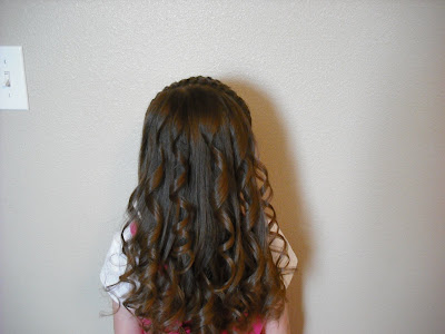 Or you can turn it into a curly Barbie hairdo. I prefer to curl it when we