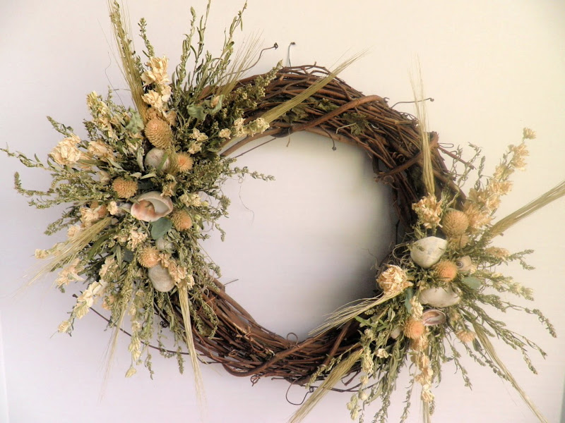 Grapevine Wreath decorated with Mixed Dried Florals and Sea Shells title=