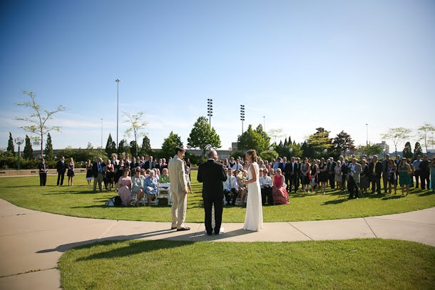 Ellie and John getting married on a sunny day in June outside the Harbor Lights room in downtown Milwaukee