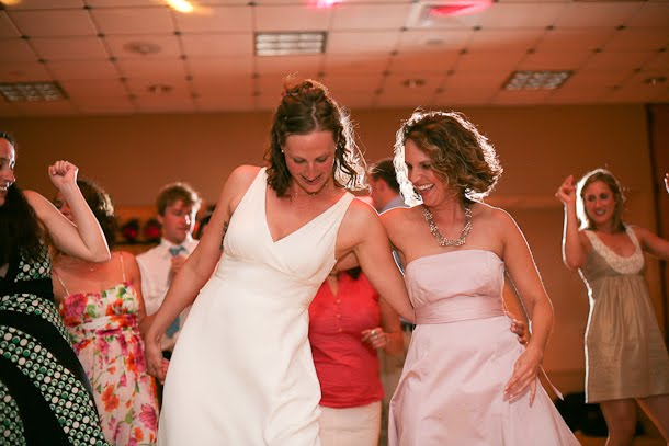 Ellie dancing with a friend at her wedding in downtown Milwaukee where Sound by Design was the DJ