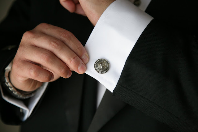 Texas cufflink detail worn by groom in Scottish attire