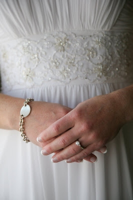 Bride clasps hands on wedding day