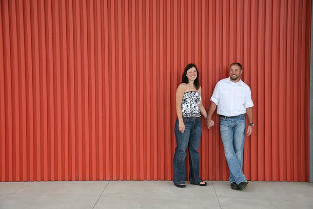 Chris and Andrea pose for engagement portrait outside the Harley-Davidson museum