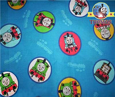 Cotton fabric featuring Thomas and friends on a blue background to cover a childs room Sodor table