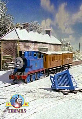 Thomas Terence and the Snow covered train station with the two faithful coachers Annie and Clarabel
