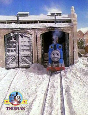 Thomas Terence and the Snow frosted railway shed doors with rails two dark lines in the white snow