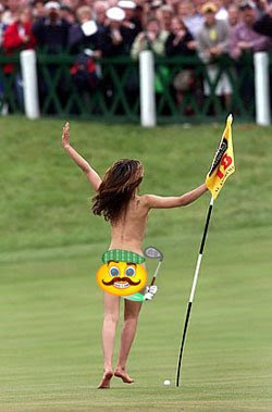 Woman on the 18th green holding golf flag