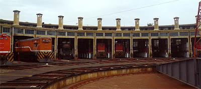 Railway roundhouse railroad shed for the storage housing of steam locomotive engines at night times