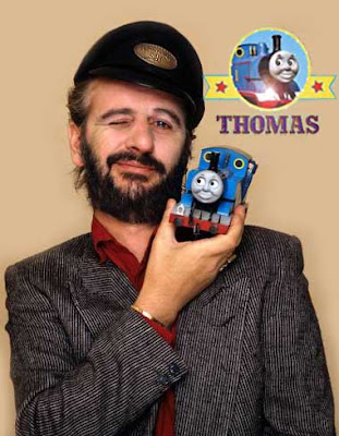 Thomas Ringo Starr narrator holding a Thomas tank young kids toy model railway set figure