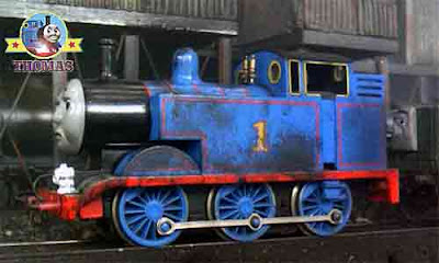 Thomas the tank engine working in a coal yard all day the little blue engine was coved in coal dust