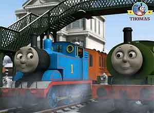 Blue Thomas the tank engine Percy the green train building big snowman on the winter Island of Sodor