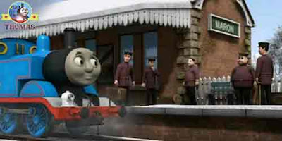 Train Thomas the tank engine at Maron station entrance with a coal pit musical brass band conductor