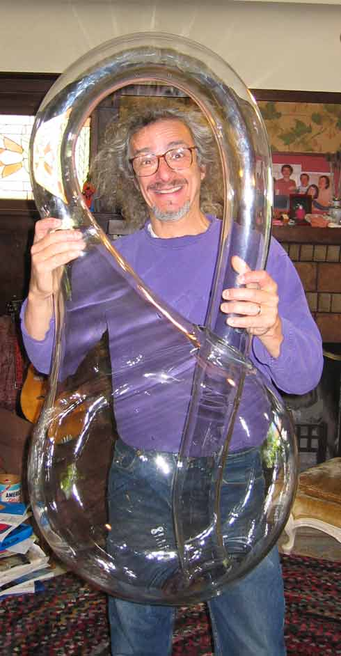 Giant Klein Bottle Held by Professor Clifford Stoll (click on picture for manufacturer's website)