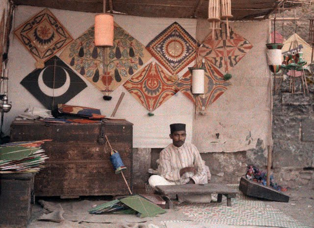 A kite merchant sits in his store in Bombay (Mumbai) - 1926