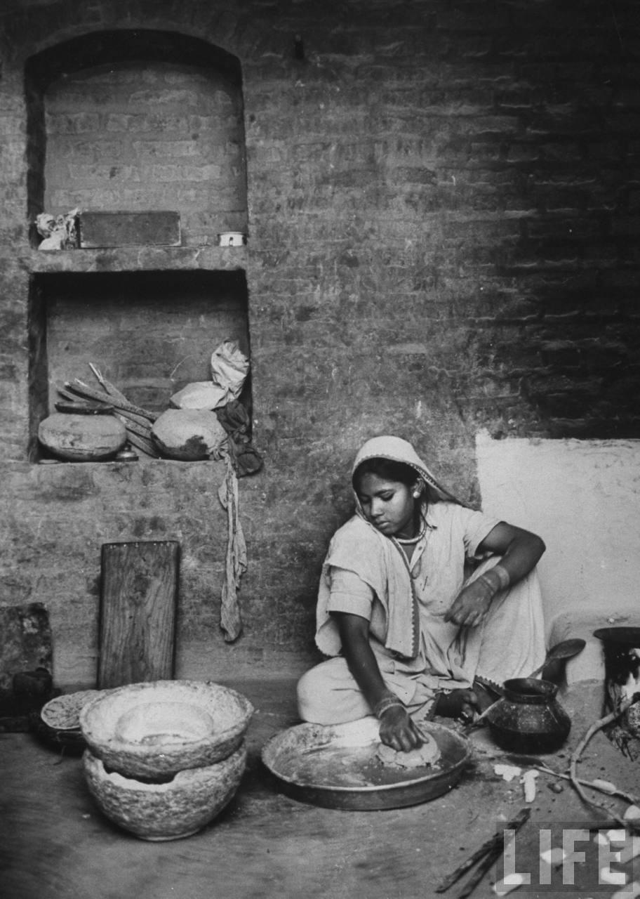 Indian Village girl making chupattis - 1962