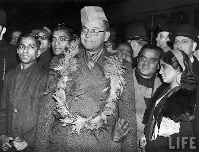 Subhas Chandra Bose (C) being greeted w. garland of flowers after his arrival in Victoria Station