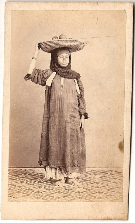Standing Photograph of a Woman with a Fruit Busket on her head - 1875