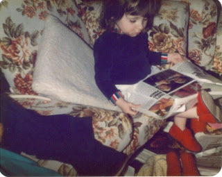 Me aged about 3 sitting on the sofa reading a magazine