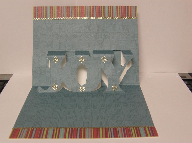 http://3.bp.blogspot.com/_pLmMug9YFkw/TO-i5xOsGUI/AAAAAAAAC8I/PSVySBcA_lQ/s1600/Christmas-Card-Joy-Pop-Up.jpg