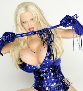 Sexy Sabrina Sabrok punishing boys in blue dress picture