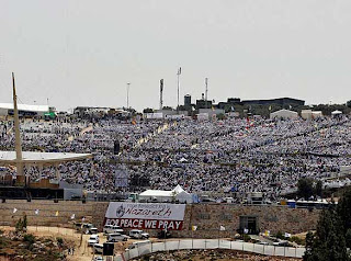 The crowded people of mass celebrating the event of Pope Benedict XVI at Mount Precipice in the northern Israeli city of Nazareth photo