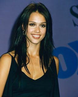 Jessica Alba smiling in black hair style on stage with black gown at a celebration(event) sexy gallery