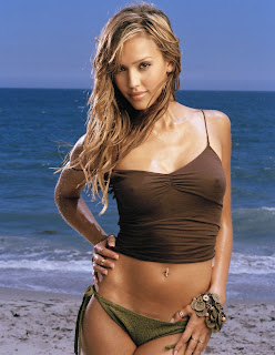 Maxim shoot working still of Jessica Alba at the beach with sea blue water background and in brown bikini sexy picture