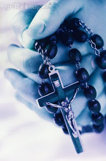 Christian Cross with Holy Black rosary beads and small Jesus Christ crucifixion religious Christian image