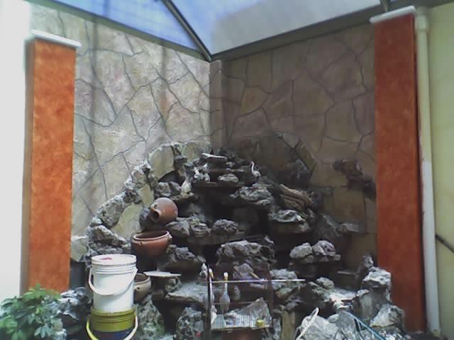 imitacion de piedra rustica en fuente de patio
