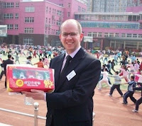 No.3 Zhongguncun Primary School, Beijing. The 600 pupils of the school were practicing a choreographed kung fu display in preparation for their performance at the opening ceremony of 2008 Beijing Olympic games! It was an amazing experience to watch and listen to the powerful music which accompanied this fantastic spectacle... School Principal and pupils had just presented our group with gifts including the official olympic mascots which I am holding...