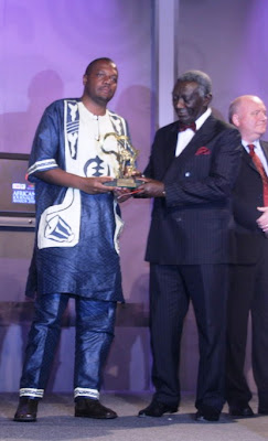 Hopewell Chin'ono Being Presented With the 2008 CNN MultiChoice African Journalist Award by Ghana's President John Agyekum Kufuor