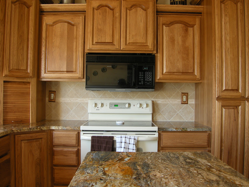 Kitchen Update: Stone Backsplash & Window Wrap title=