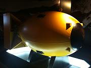 Below is a photo of an original bomb casing of a plutonium bomb, . (bomb)