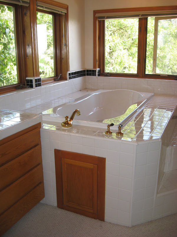 platfrom soaking tub was installed in a large bathroom area title=