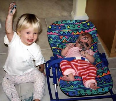 kid-using-marker-to-paint-face-of-his-baby-brother