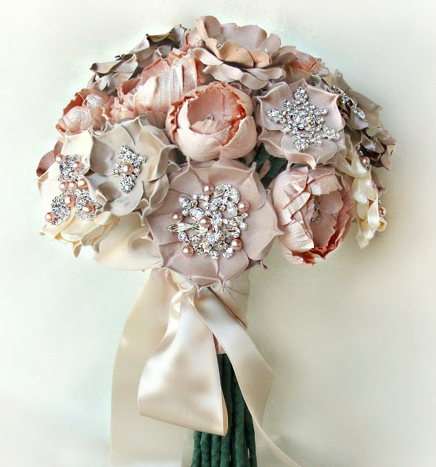I used blush champagne and ivory silks to create this arrangement